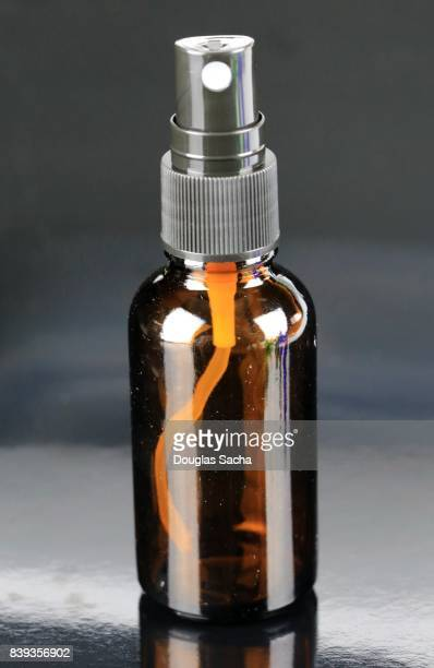 alternative health in an essential oil bottle - tea tree oil stock photos and pictures