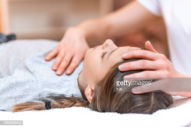 alternative medicine for children - osteopath stock photos and pictures