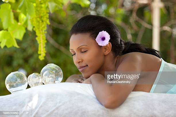 alternative therapy by vacuum cupping. - massage black woman stock photos and pictures