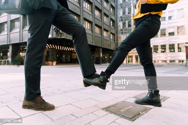 alternative to handshake during covid-19 pandemic - greeting stock pictures, royalty-free photos & images
