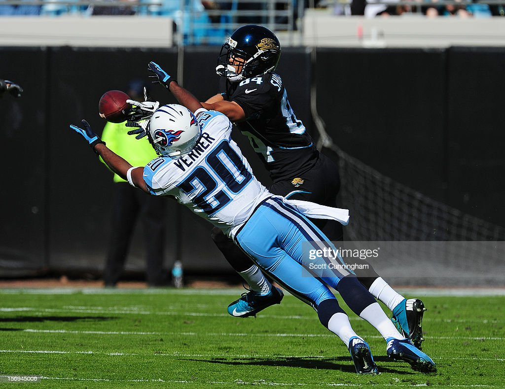Alterraun Verner #20 of the Tennessee Titans intercepts a pass intended for Cecil Shorts III #84 of the Jacksonville Jaguars at EverBank Field on November 25, 2012 in Jacksonville, Florida
