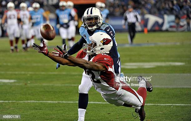 Alterraun Verner of the Tennessee Titans watches as Andre Roberts of the Arizona Cardinals dives for but misses a pass at LP Field on December 15...