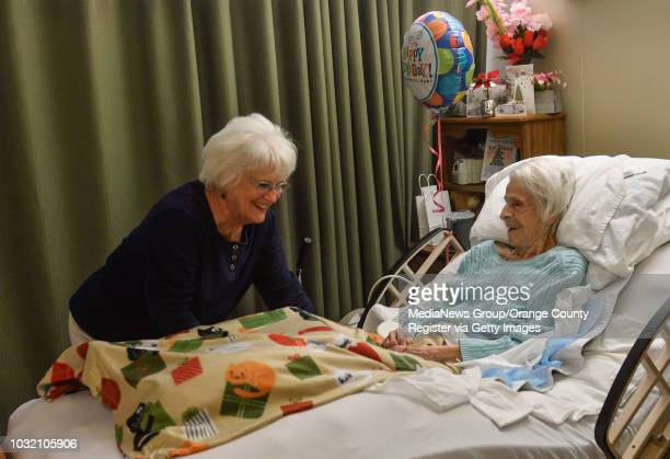 Altha Gardner right chats with longtimefriend Donna Puckett in her room at Town and Country Senior Living in Santa Ana on Wednesday Dec 20 2017...