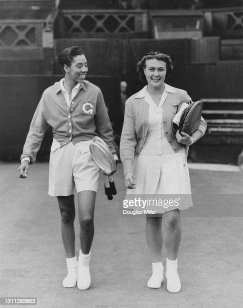 Althea Gibson of the United States and Patricia Ward of Great Britain walk onto Centre Court for their Women's Singles Second Round match at the...