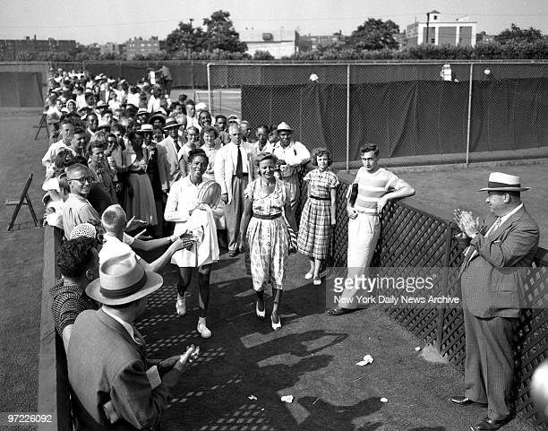 Althea's Dream Comes True Althea Gibson leaves Forest Hills court accompanied by Alice Marble and applause of spectators