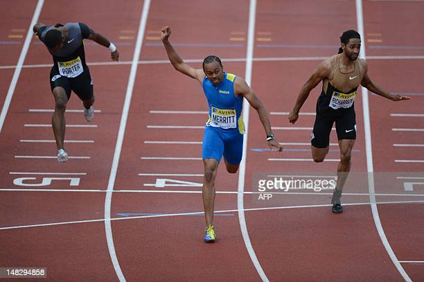US althete Aries Merritt finishes ahead of US althete Jason Richardson and US athlete Jeff Porter to win the men's 110m hurdles final at the 2012...