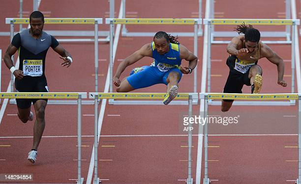 US althete Aries Merritt takes a hurdle ahead of US athlete Jeff Porter and US althete Jason Richardson to win the men's 110m hurdles final at the...