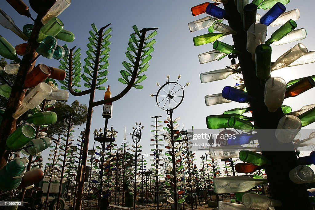 Although collectors of bottles and other items found in the desert have all but gone by the wayside, Elmer Long carries on the tradition with his continual creation of a forest of ?bottle trees? on old Route 66 on June 15, 2007 near Oro Grande, California. Route 66 opened in 1926 stretching from Chicago to Los Angeles and became a western migration route for people looking for work during the great depression of the 1930's or to escape the Dust Bowl disaster. Later it offered vacation getaways and driving adventures until 1985 when it was decommissioned as a federal highway. Due to neglect and commercial development Route 66, the first highway to connect the Midwest with the West Coast, has recently been added to the biennially compiled list of the world's most endangered landmarks by the World Monuments Fund and the National Trust for Historic Preservation's yearly list of the 11 most endangered historic places in America.