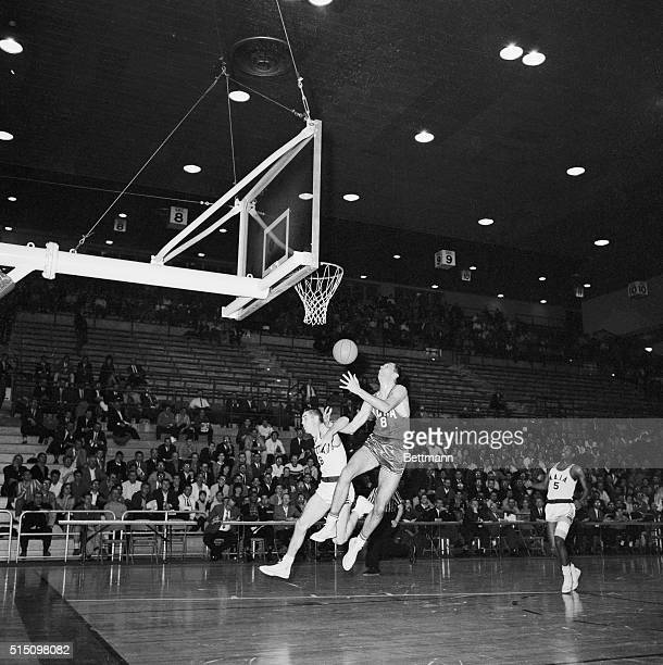 Although hampered by Cecil Tuttle of Georgetown Kentucky who is playing for the NAIA AllStars Bill Bradley of Princeton who is playing for the NCAA...