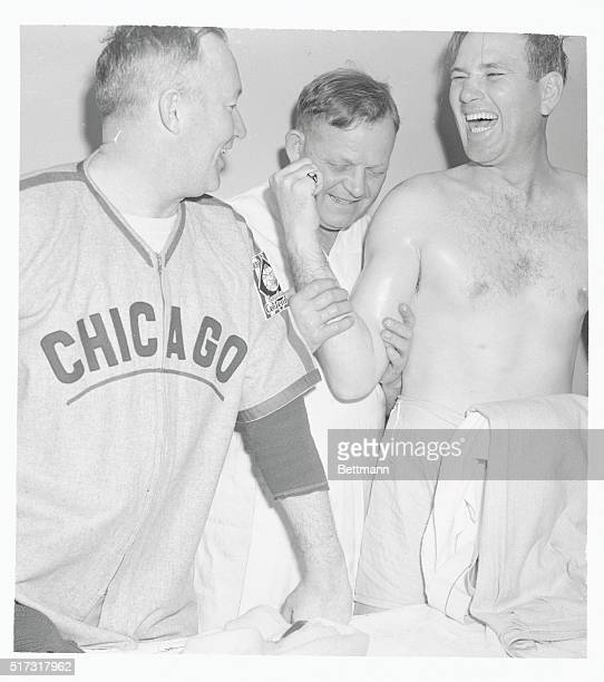 Although Jerome Dizzy Dean Chicago Cubs pitcher claims he isn't ticklish he puts on a big laugh as Manager Gabby Hartnett and Trainer Andy Lotshaw...