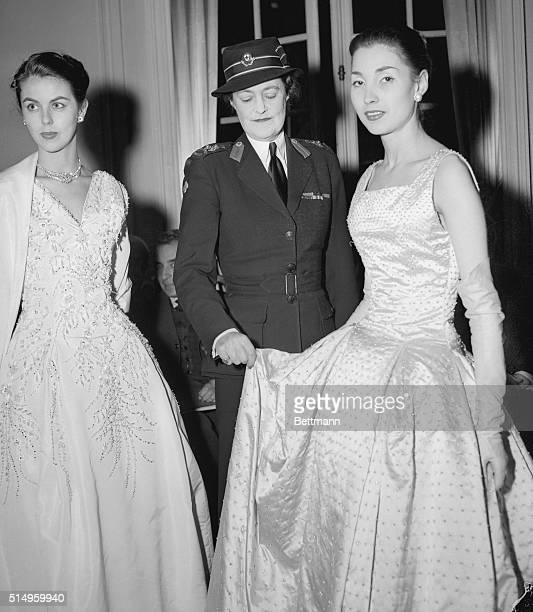 Although she wears the strictlytailored uniform of the British Red Cross the Duchess of Marlborough has only temporarily turned her back on feminine...