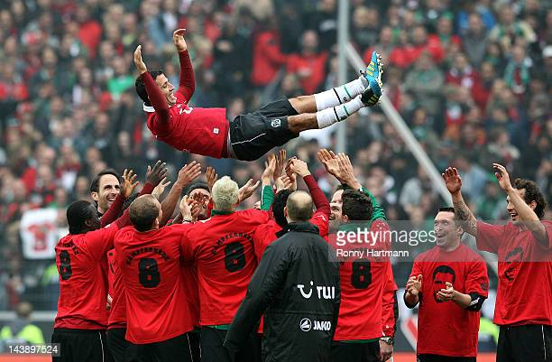 Altin Lala of Hannover is thrown into the air after the Bundesliga match between Hannover 96 and 1 FC Kaiserslautern at AWD Arena on May 05 2012 in...