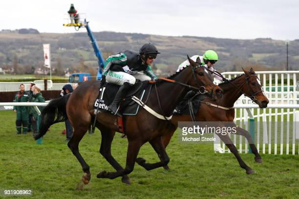Altior ridden by Nico de Boinville on his way to winning the Betway Queen Mother Champion Chase ahead of Min ridden by Paul Townend during Cheltenham...
