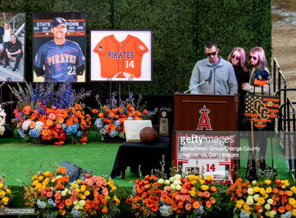Altobelli left is joined by Lexi Altobelli and Carly Konigsfeld during the memorial service for Orange Coast College baseball head coach John...