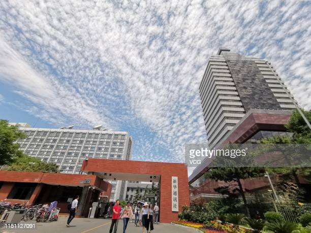 Altocumulus clouds appear over buildings of Xinhua News Agency on May 22 2019 in Beijing China