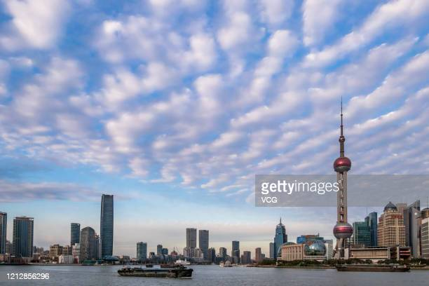 Altocumulus clouds form over The Bund on March 16, 2020 in Shanghai, China.