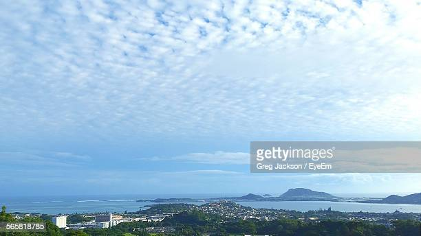 altocumulus clouds over city at seaside - altocumulus stockfoto's en -beelden