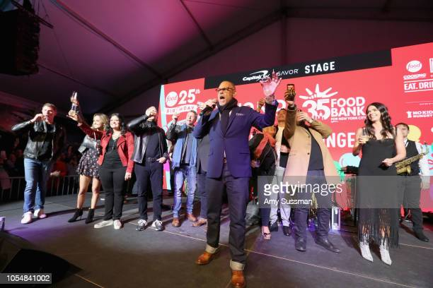 Alton Brown Jeff Mauro Alex Guarnaschelli Marc Murphy Katie Lee Bobby Flay Anne Burrell Geoffrey Zakarian Giada De Laurentiis and Adam Richman make a...