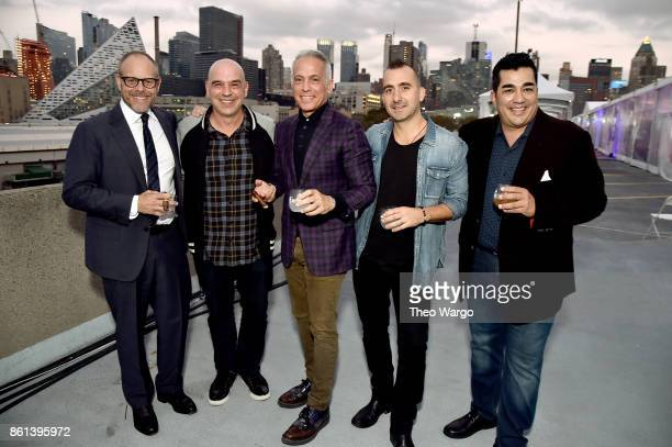 Alton Brown Michael Symon Geoffrey Zakarian Marc Forgione and Jose Garces attend the Food Network Cooking Channel New York City Wine Food Festival...