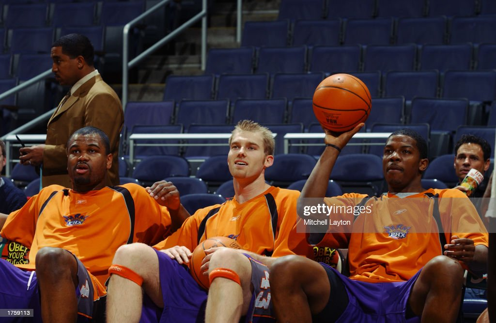 Ford, Voskuhl and Johnson look on during warm-ups : News Photo