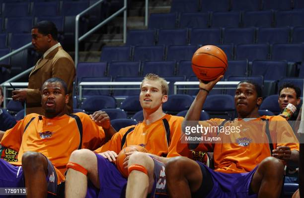 Alton Ford Jake Voskuhl and Joe Johnson of the Phoenix Suns look on during warmups prior to the start of the game against the Washington Wizards at...