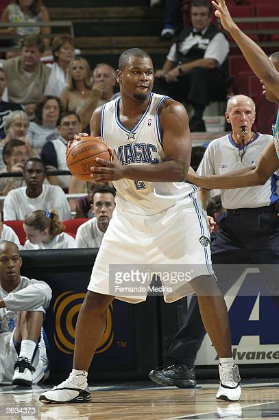 Alton Ford of the Orlando Magic looks to play the ball against the New Orleans Hornets during a preseason game at TD Waterhouse Centre on October 14...