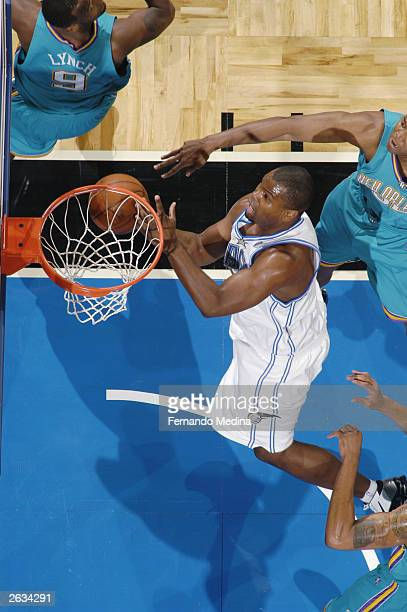 Alton Ford of the Orlando Magic shoots ahead of David West of the New Orleans Hornets during a preseason game at TD Waterhouse Centre on October 14...