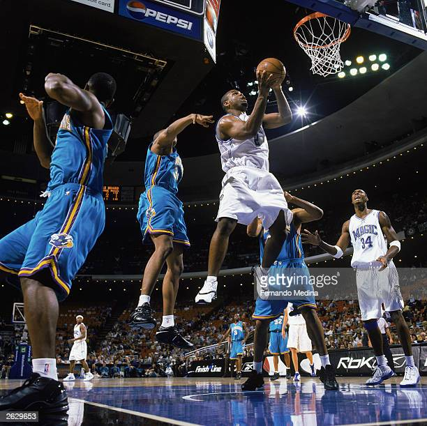 Alton Ford of the Orlando Magic takes the ball to the hoop during the NBA preseason game against the New Orleans Hornets at TD Waterhouse Centre on...