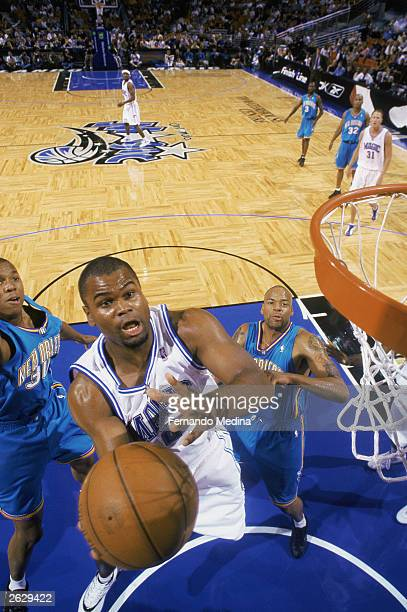 Alton Ford of the Orlando Magic takes the ball up during the NBA preseason game against the New Orleans Hornets at TD Waterhouse Centre on October 14...