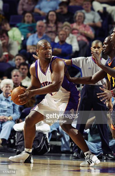 Alton Ford of the Phoenix Suns looks to pass during the NBA game against the Golden State Warriors at America West Arena on February 1 2003 in...