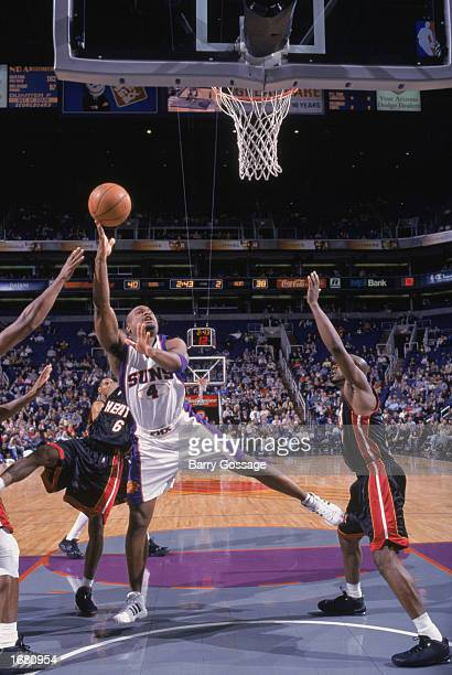 Alton Ford of the Phoenix Suns puts up a shot against the Miami Heat during the NBA game at America West Arena on December 2 2002 in Phoenix Arizona...