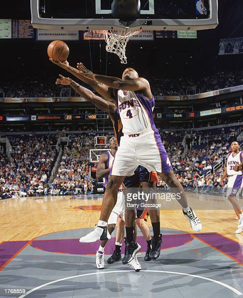 Alton Ford of the Phoenix Suns takes the ball up during the game against the Golden State Warriors at America West Arena on February 2 2003 in...