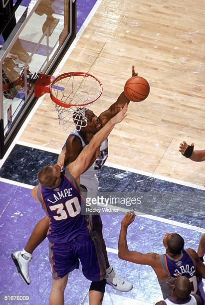 Alton Ford of the Sacramento Kings and Maciej Lampe of the Phoenix Suns battle for a rebound during a preseason game at Arco Arena on October 29 2004...