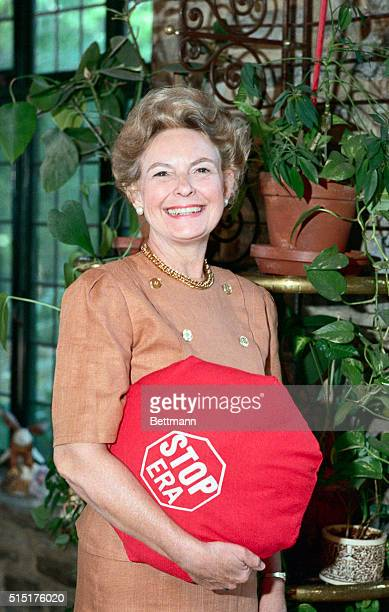 Phyllis Schlafly seen at home holding a pillow saying STOP ERA credited with singlehandedly killing the Equal Rights Amendment Schlafly the strident...