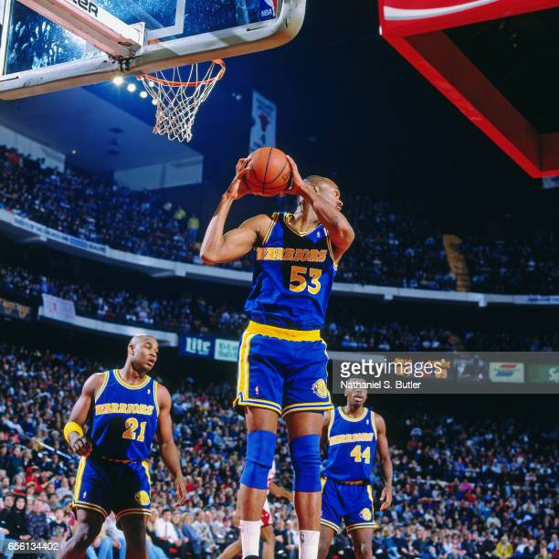 Alton Lister of the Golden State Warriors rebounds against the Chicago Bulls circa 1993 at Chicago Stadium in Chicago Illinois NOTE TO USER User...