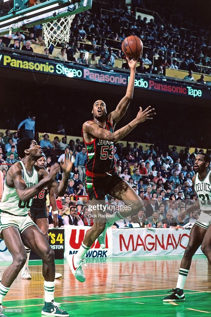 Alton Lister #53 of the Milwaukee Bucks shoots a layup against Robert Parish #00 of the Boston Celtics during a game played in 1983 at the Boston Garden in Boston, Massachusetts.