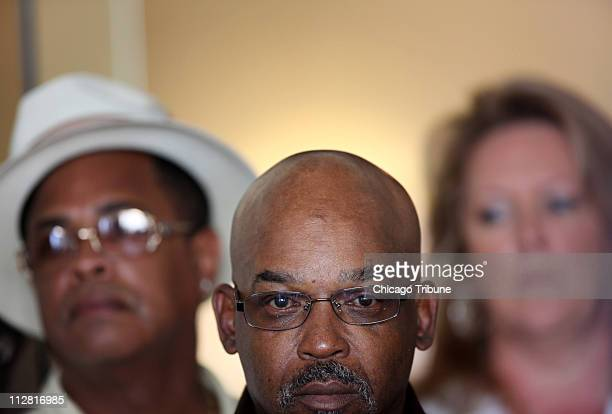 Alton Logan listens as his attorney Jon Loevy speaks at a press conference at the law offices of Loevy and Loevy Attorneys at Law to talk about the...