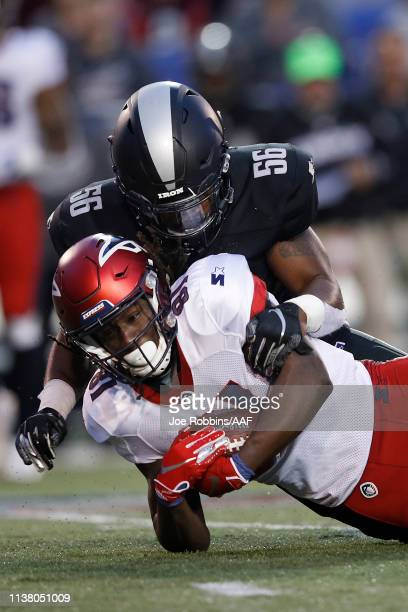 Alton Pig Howard of the Memphis Express is tackled by Shaheed Salmon  #56 of the Birmingham Iron during the first quarter of their Alliance of...