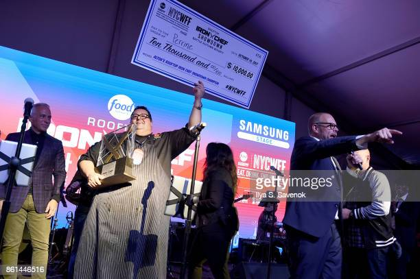 Alton's Rooftop Iron Chef Showdown Champion Chef Michael Mignano of Perrine accepts his award onstage the Food Network Cooking Channel New York City...