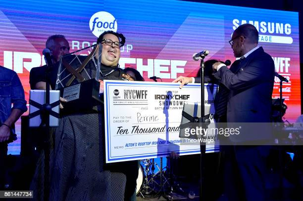 Alton's Rooftop Iron Chef Showdown Champion winner Chef Michael Mignano of Perrine accepts his award at the Food Network Cooking Channel New York...