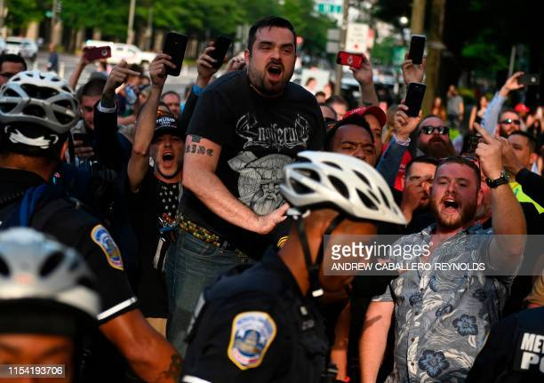Altright activists taunt anti fascists outside the Trump Hotel after a Demand Free Speech rally in Washington DC on July 6 2019
