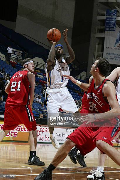 Altron Jackson of the Roanoke Dazzle drives against the Fayetteville Patriots during the NBDL Playoffs at the Crown Coliseum on March 25, 2003 in...