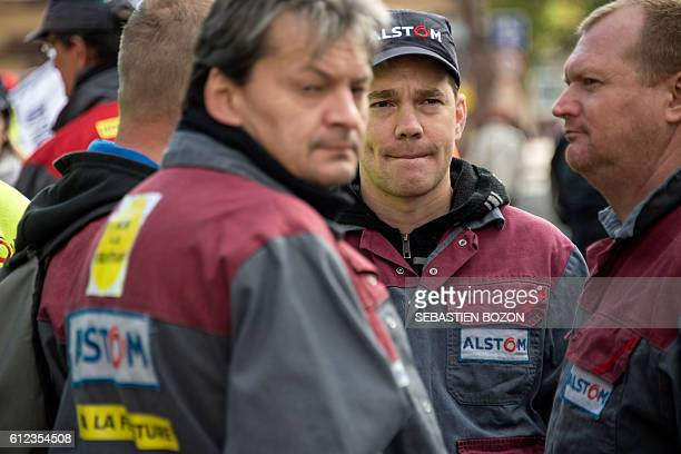 Altsom's workers demonstrate in front of the Prefecture on October 4 2016 in Belfort eastern France as French secretary of State and officials...