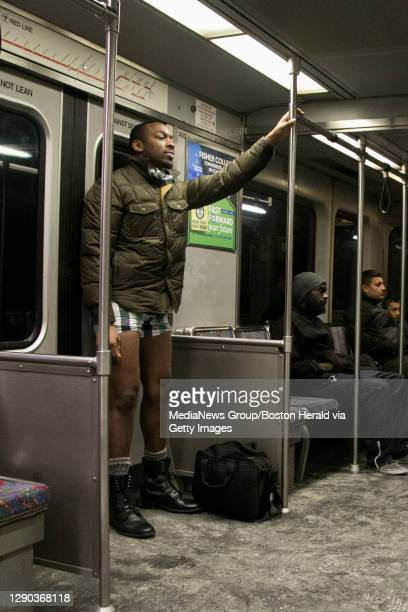 -- Alua Aumade of Boston, stands on the Red Line after removing his pants during the 2015 No Pants Subway Ride on Jan. 11, 2015. Herald Photo by...