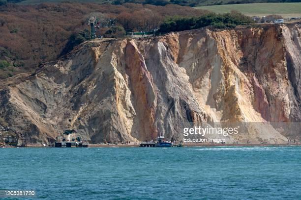 Alum Bay, Isle of Wight, England, UK, The multi colored sand cliffs of Alum Bay below Headon Warren on the west coast of the island.