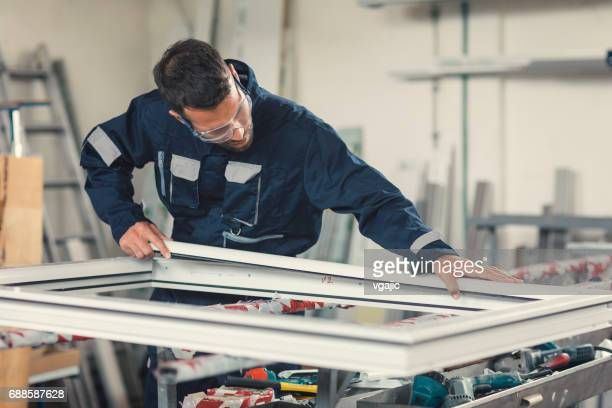aluminium and pvc industry worker - window stock pictures, royalty-free photos & images