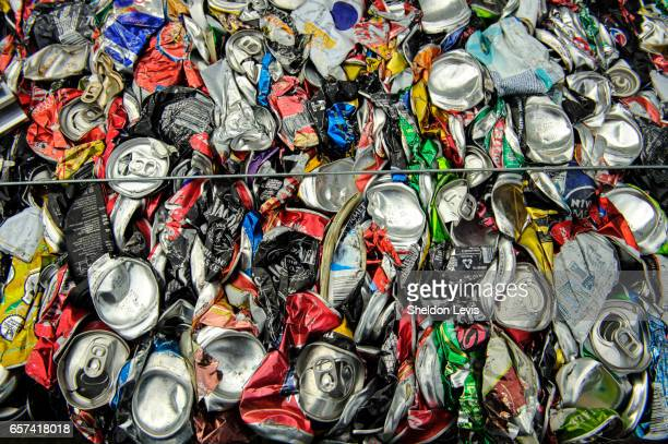 aluminium cans crushed into a cube - by sheldon levis stock pictures, royalty-free photos & images
