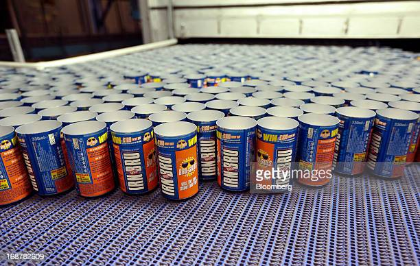 Aluminium cans produced for AG Barr Plc's Irn Bru drink travel along a conveyor belt during production at Rexam Plc's beverage can plant in Wakefield...