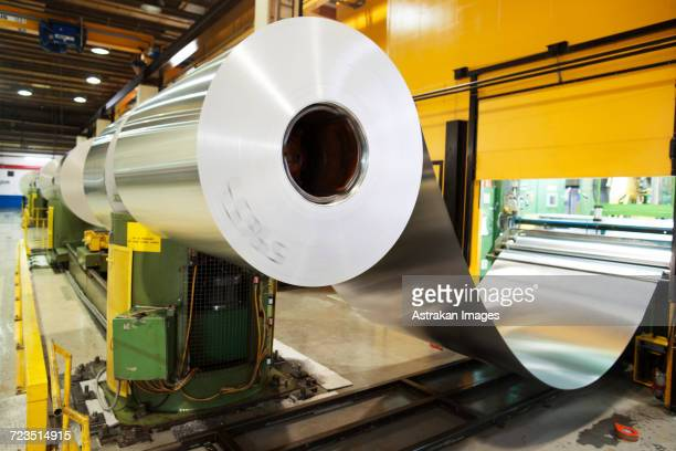 aluminium metal rolled up in factory - sheet metal stock pictures, royalty-free photos & images