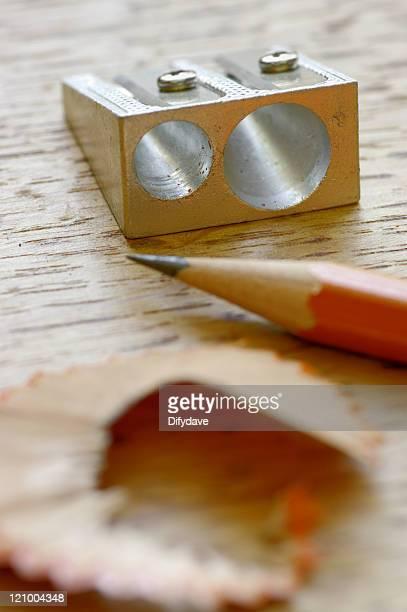 Aluminium Sharpener Pencil And Shaving On Oak Table Top